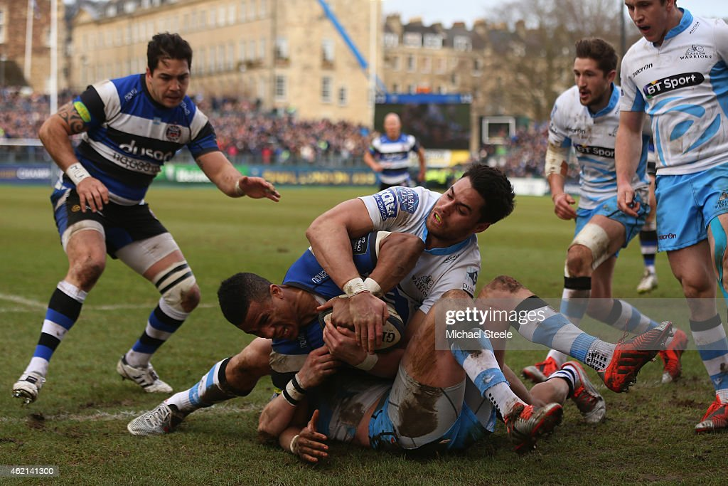 Anthony Watson of Bath is denied a try as Finn Russell and Sean Maitland of Glasgow prevent the ball from being grounded during the European Rugby...