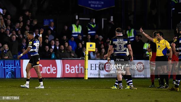 Anthony Watson of Bath is shown a red card by Referee Greg Garner during the Aviva Premiership match between Bath Rugby and Saracens at the...
