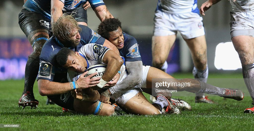 Anthony Watson of Bath is tackled by Thibaut Privat and <a gi-track='captionPersonalityLinkClicked' href=/galleries/search?phrase=Benjamin+Fall&family=editorial&specificpeople=5405287 ng-click='$event.stopPropagation()'>Benjamin Fall</a> during the European Rugby Champions Cup pool 4 match between Montpellier and Bath at Stade Yves-du-Manoir on December 5, 2014 in Montpellier, France.