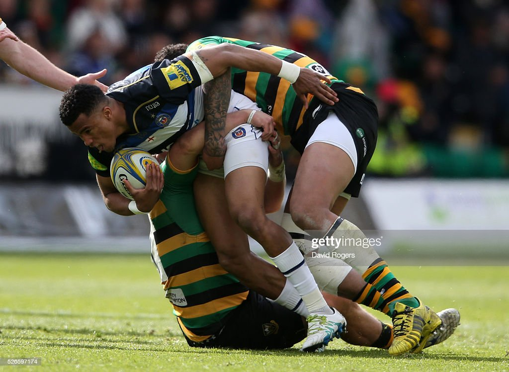 Anthony Watson of Bath is tackled during the Aviva Premiership match between Northampton Saints and Bath at Franklin's Gardens on April 30, 2016 in Northampton, England.
