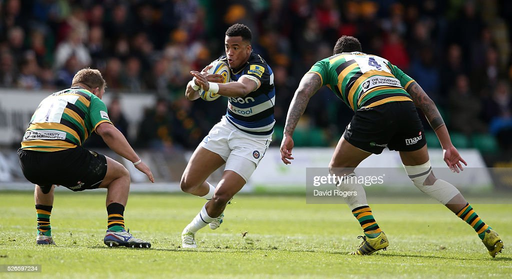 Anthony Watson of Bath runs with the ball during the Aviva Premiership match between Northampton Saints and Bath at Franklin's Gardens on April 30, 2016 in Northampton, England.