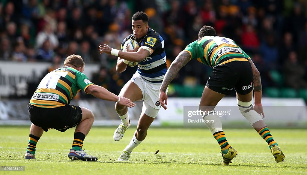 Anthony Watson of Bath takes on Alex Waller (L) and Courtney Lawes during the Aviva Premiership match between Northampton Saints and Bath at Franklin's Gardens on April 30, 2016 in Northampton, England.