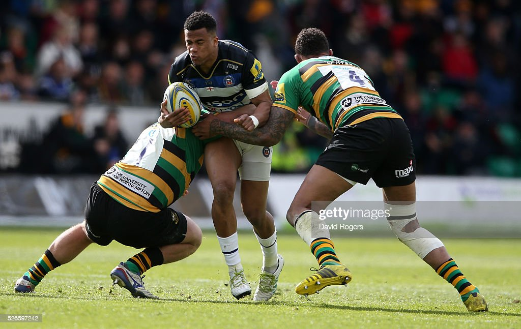 Anthony Watson of Bath takes on Alex Waller (L) and <a gi-track='captionPersonalityLinkClicked' href=/galleries/search?phrase=Courtney+Lawes&family=editorial&specificpeople=5385543 ng-click='$event.stopPropagation()'>Courtney Lawes</a> during the Aviva Premiership match between Northampton Saints and Bath at Franklin's Gardens on April 30, 2016 in Northampton, England.