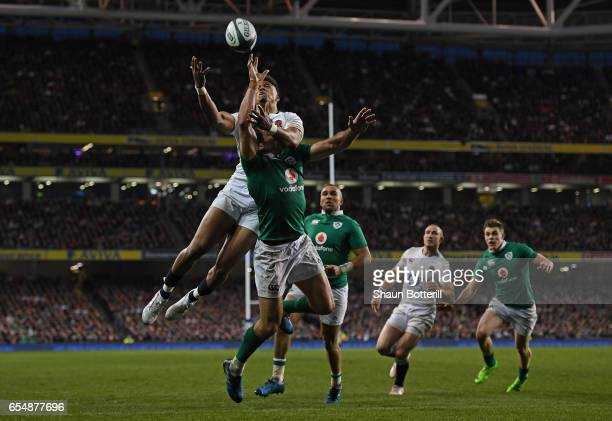 Anthony Watson of England and Jared Payne of Ireland compete for a high ball during the RBS Six Nations match between Ireland and England at the...