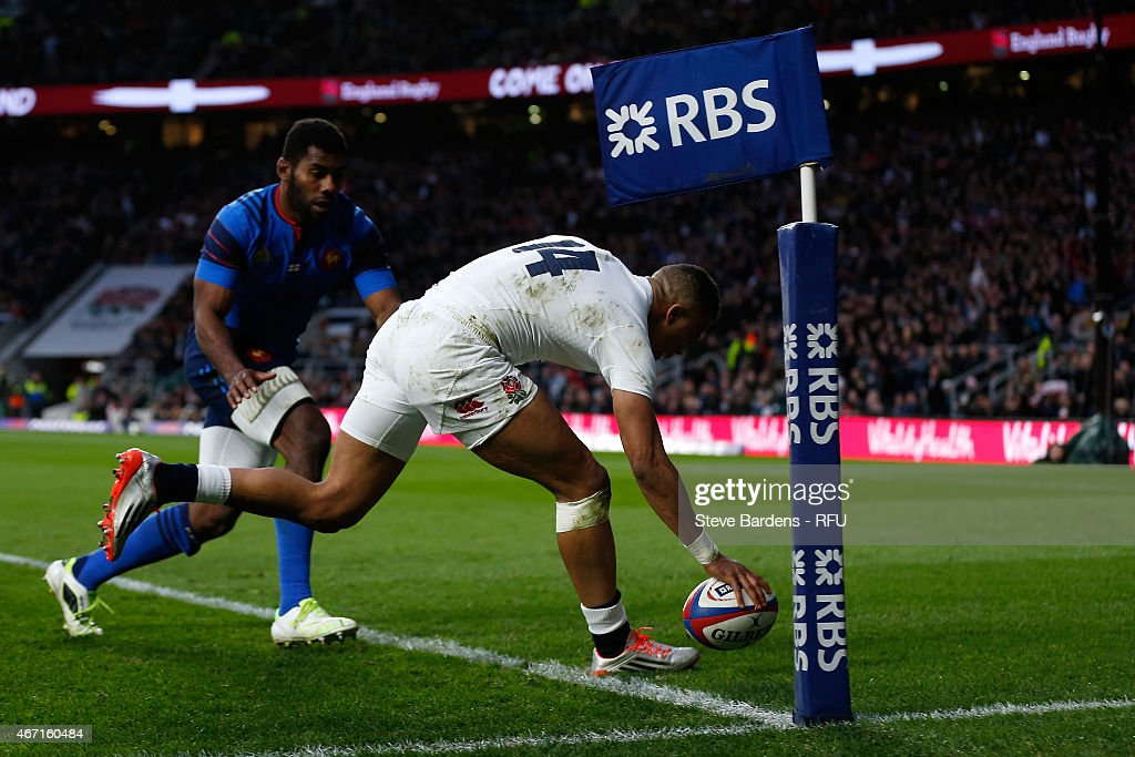 Anthony Watson of England beats Noa Nakaitaci of France to score a try during the RBS Six Nations match between England and France at Twickenham Stadium on March 21, 2015 in London, England.