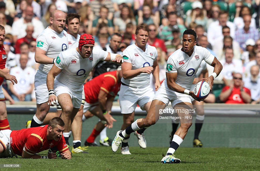 Anthony Watson of England breaks with the ball during the England v Wales International match at Twickenham Stadium on May 29, 2016 in London, England.