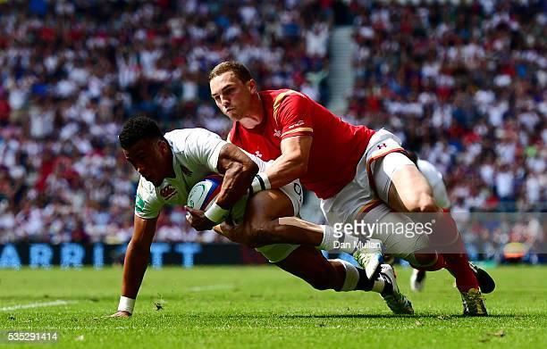 Anthony Watson of England dives over for his side's second try as he is tackled by George North of Wales during the Old Mutual Wealth Cup match...