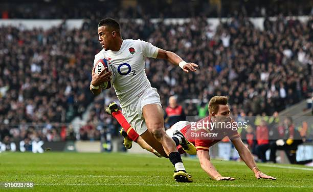 Anthony Watson of England evades a tackle from Liam Williams of Wales to score his team's opening try during the RBS Six Nations match between...