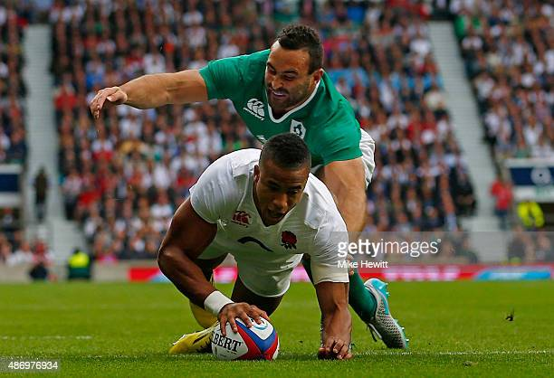 Anthony Watson of England goes over to score a try during the QBE International match between England and Ireland at Twickenham Stadium on September...