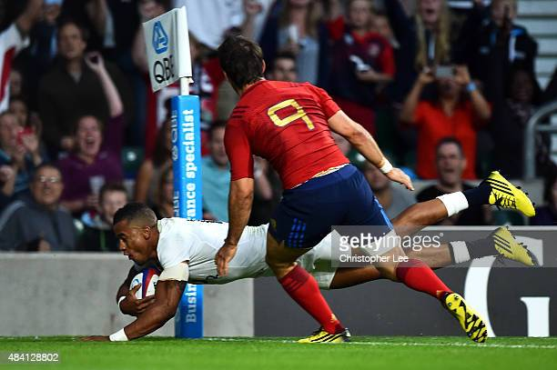 Anthony Watson of England goes over to score the opening try during the QBE International match between England and France at Twickenham Stadium on...