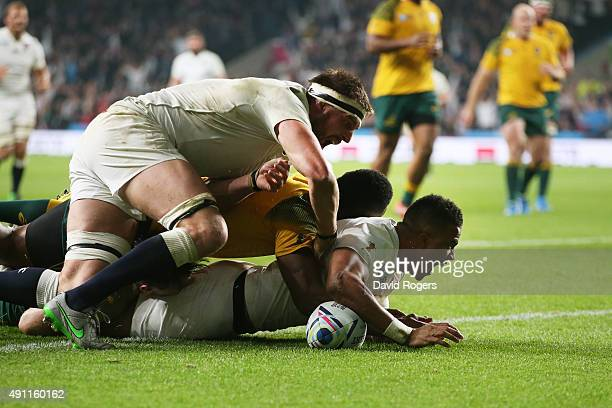 Anthony Watson of England is congratulated by Tom Wood of England after scoring the first England try during the 2015 Rugby World Cup Pool A match...