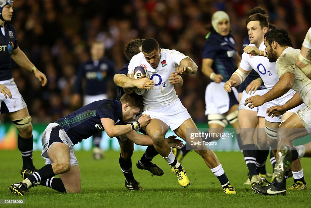 Anthony Watson of England is tackled by <a gi-track='captionPersonalityLinkClicked' href=/galleries/search?phrase=Finn+Russell&family=editorial&specificpeople=9193124 ng-click='$event.stopPropagation()'>Finn Russell</a> of Scotland and Matt Scott of Scotland during the RBS Six Nations match between Scotland and England at Murrayfield Stadium on February 6, 2016 in Edinburgh, Scotland.