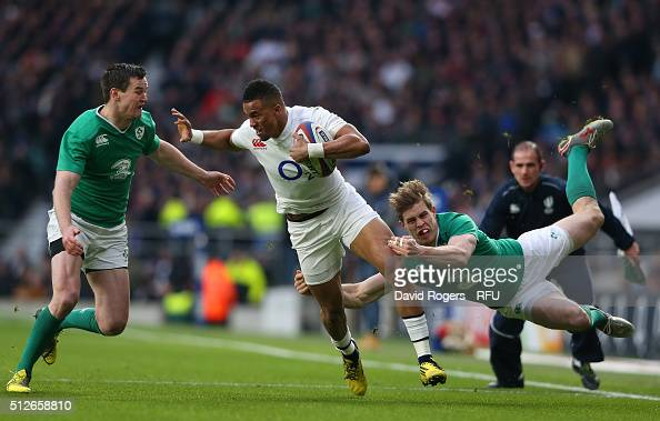 Anthony Watson of England is tackled by Jonathan Sexton and Andrew Trimble of Ireland during the RBS Six Nations match between England and Ireland at...