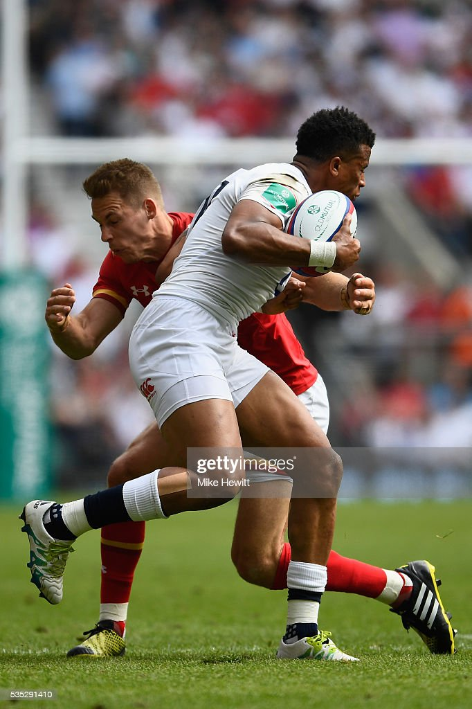 Anthony Watson of England is tackled by <a gi-track='captionPersonalityLinkClicked' href=/galleries/search?phrase=Liam+Williams&family=editorial&specificpeople=7852399 ng-click='$event.stopPropagation()'>Liam Williams</a> of Wales during the Old Mutual Wealth Cup between England and Wales at Twickenham Stadium on May 29, 2016 in London, England.