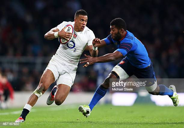 Anthony Watson of England is tackled by Noa Nakaitaci of France during the RBS Six Nations match between England and France at Twickenham Stadium on...