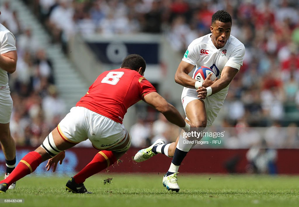 Anthony Watson of England is tackled by <a gi-track='captionPersonalityLinkClicked' href=/galleries/search?phrase=Taulupe+Faletau&family=editorial&specificpeople=12444794 ng-click='$event.stopPropagation()'>Taulupe Faletau</a> during the England v Wales International match at Twickenham Stadium on May 29, 2016 in London, England.