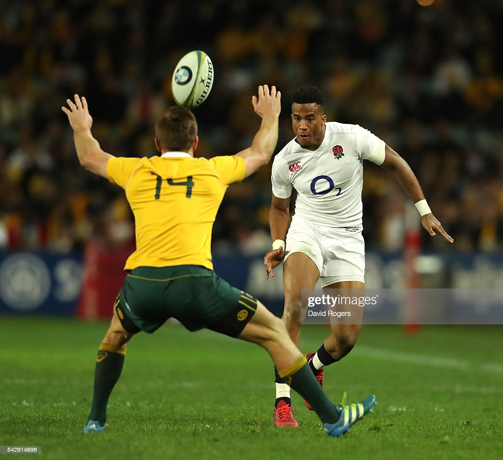 Anthony Watson of England kicks past Dane Haylett-Petty during the International Test match between the Australian Wallabies and England at Allianz Stadium on June 25, 2016 in Sydney, Australia.
