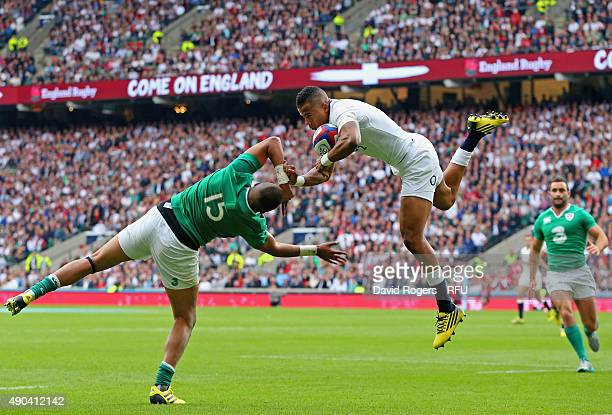 Anthony Watson of England takes the high ball over Simon Zebo of Ireland during the QBE International match between England and Ireland at Twickenham...