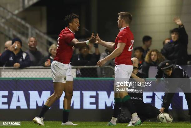 Anthony Watson of the British Irish Lions is congratulated by teammate Owen Farrell after scoring his team's first try during the 2017 British Irish...