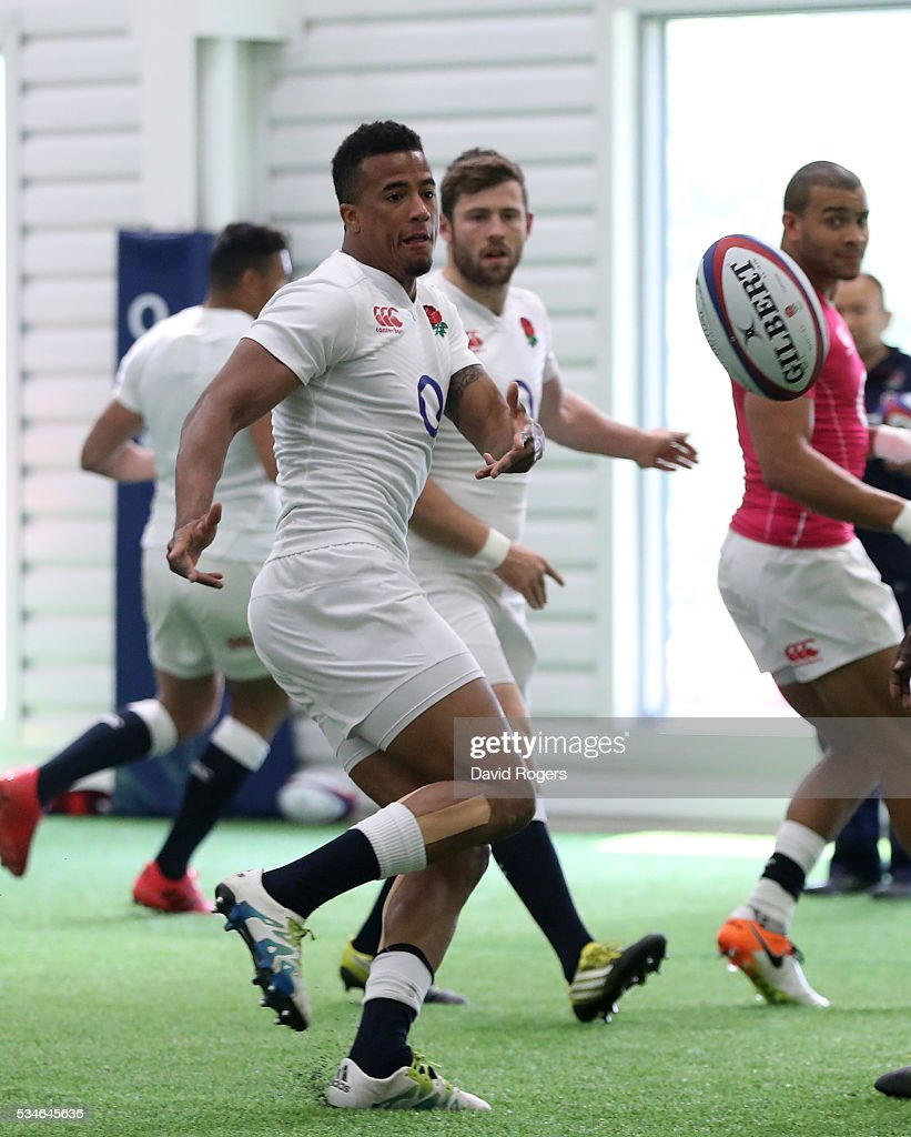 Anthony Watson passes the ball during the England training session held at Pennyhill Park on May 27, 2016 in Bagshot, England.