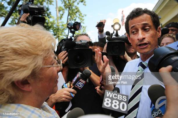 Anthony Weiner a leading candidate for New York City mayor speaks with residents in Staten Island on a visit to homes damaged by Hurricane Sandy on...