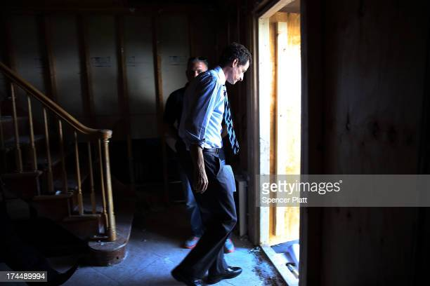 Anthony Weiner a leading candidate for New York City mayor walks out of a storm damaged home after meeting with residents in Staten Island whose...