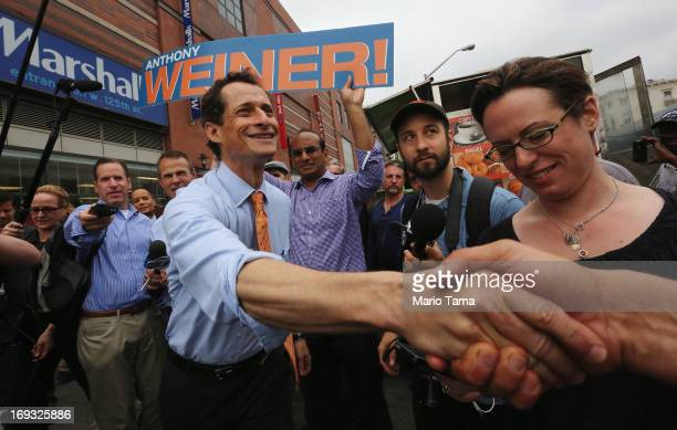 Anthony Weiner greets a man while courting voters outside a Harlem subway station a day after announcing he will enter the New York mayoral race on...
