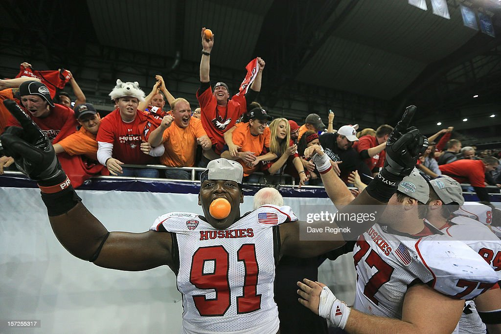 Anthony Wells #91 of the Northern Illinois Huskies celebrates with the fans after defeating the Kent State Huskies 44-37 during the Mid-American Conference Championship game at Ford Field on November 30, 2012 in Detroit, Michigan.