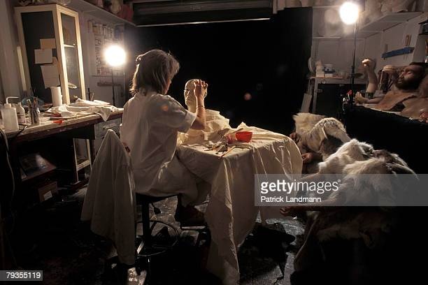 Anthropological sculptress Elisabeth Daynes applies clay representing fatty tissue to Otzi's skull in her workshop on October 1 1997 in Paris France...