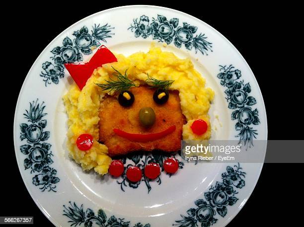 Anthropomorphic Face Made Of Shnitzel And Scrambled Eggs