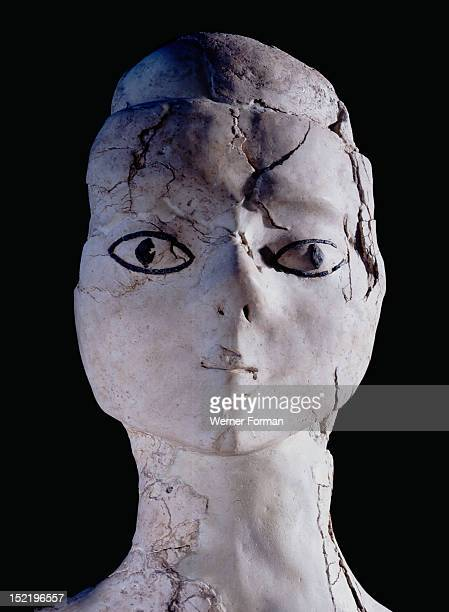 Anthropomorphic statue one of several found buried in pits in the vicinity of Ain Ghazal These statues are half size human figures and modeled in...