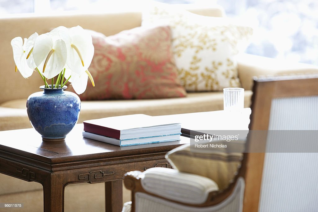 Anthuriums in vase on coffee table : Stock Photo