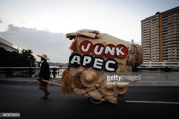 A anti APEC protester carries a native wagon as they attempt to get near the venue hosting the AsiaPacific Economic Cooperation Summit of Leaders on...