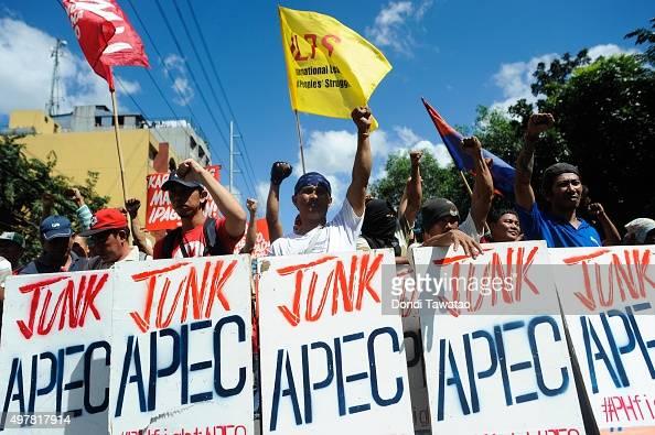 Anti Apec protestors march towards the venue hosting the Asia Pacific Economic Cooperation summit of economic leaders on November 19 2015 in Manila...