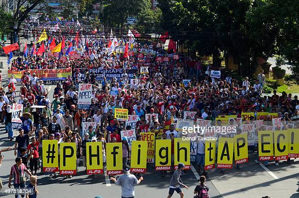 Anti Apec protestors march towards the venue hosting the Asia Pacific Economic Cooperation summit of economic leaders on November 19 2015 in Manila...