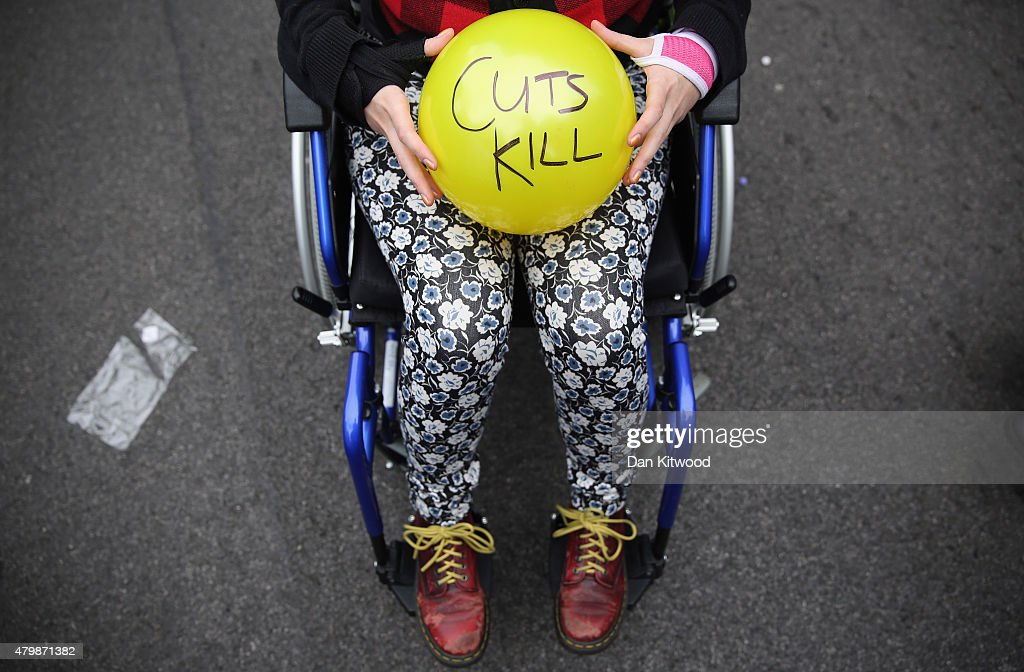 Anti austerity protesters prepare to throw balls towards Downing Street after the Chancellor of the Exchequer George Osborne left 11 Downing Street...