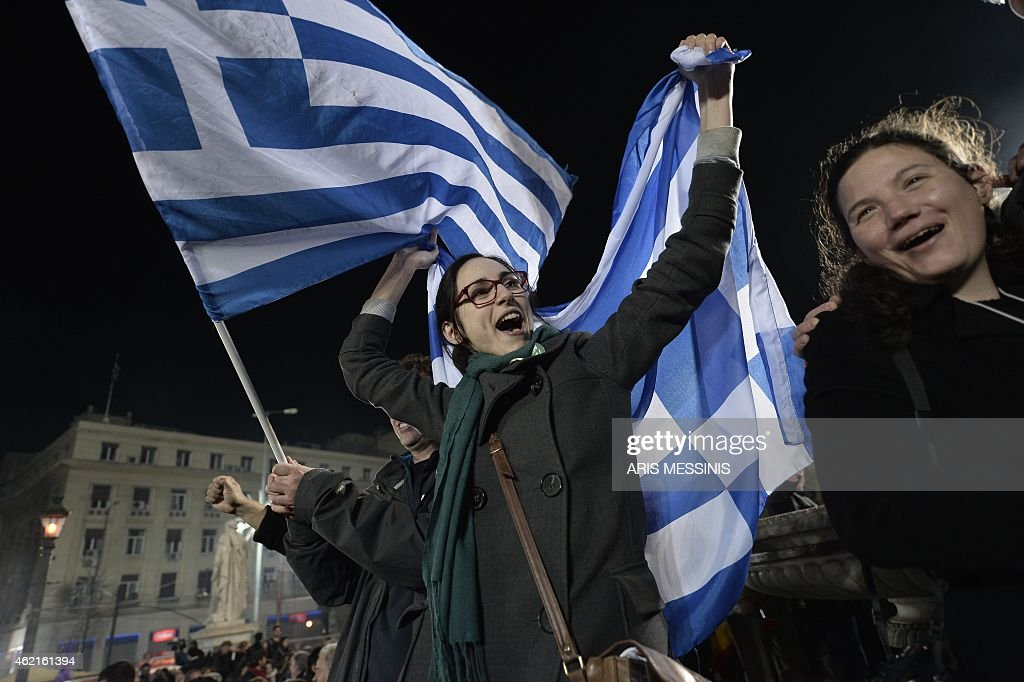 Anti austerity Syriza party supporters celebrate as leader Alexis Tsipras speaks folllowing victory in the election in Athens on January 25 2015...
