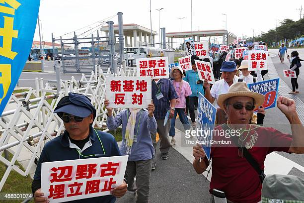 Anti base relocation protesters demonstrate in front of the US Camp Schwab on September 14 2015 in Nago Okinawa Japan After holding a hearing on...