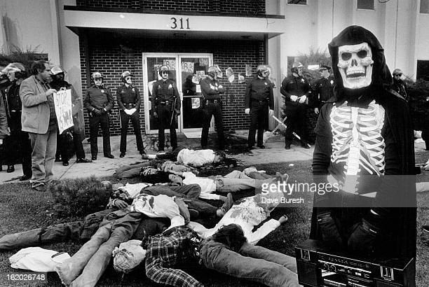 NOV 10 1987 Anti Confra Activists are met by about 40 police officer on foot in cars on motorcycles and on horse back The activists got to the front...
