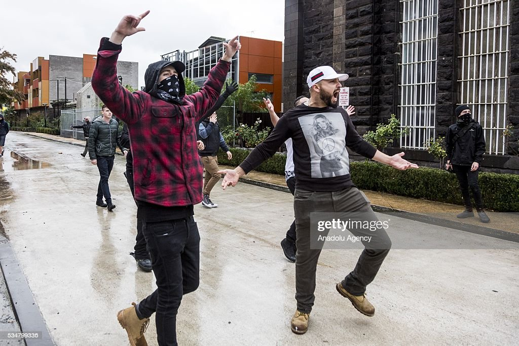 Anti Fascists and anti-racism protestors cheer as they antagonise True Blue Crew and UPF members during a 'Say No To Racism' protest and a counter 'Stop the Far Left' rally in Coburg Melbourne, Australia on May 28, 2016. Seven men were arrested after a violent brawl erupted between rival protesters at an anti-racism rally in Melbourne's inner-north. Anti-Facists clashed with Anti-Islam nationalists who go by the name 'True Blue Crew'.