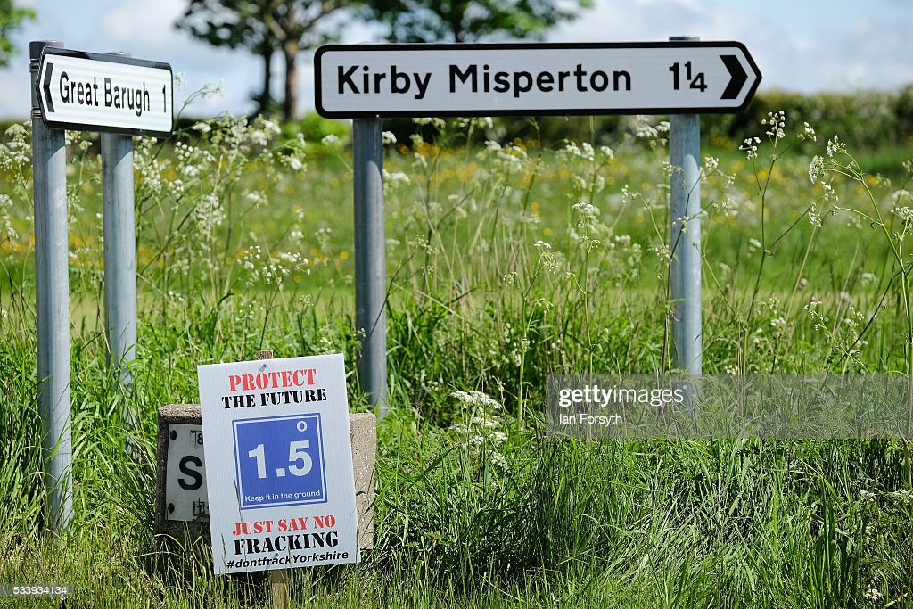 Anti fracking placards and signs are displayed on the roads approaching the village of Kirby Misperton on May 24, 2016 in Malton, England. North Yorkshire Planning and Regulatory Committee voted seven to four in favour of a planning application submitted by Third Energy to conduct fracking at the KM8 drilling site near the village. Hydraulic Fracturing, or fracking, is a technique designed to recover gas and oil from shale rock.