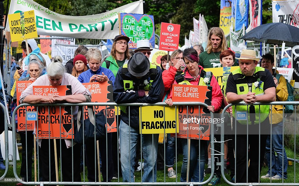 Anti fracking protestors listen to a live feed of the discussion as they stand outside the County Hall building in Northallerton as the County...