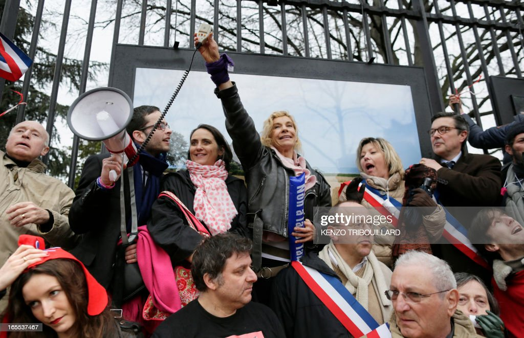 Anti gay marriage activist Frigide Barjot (C) takes part in a protest against gay marriage on April 4, 2013 in front of the French Senate in Paris, on the first day of the debate at France's upper house on the controversial bill to legalise same-sex marriage and adoption. While the upper house is unlikely to reject the groundbreaking reform, it is still expected to be a tight vote as the ruling Socialists enjoy a smaller majority in the Senate than in the National Assembly.