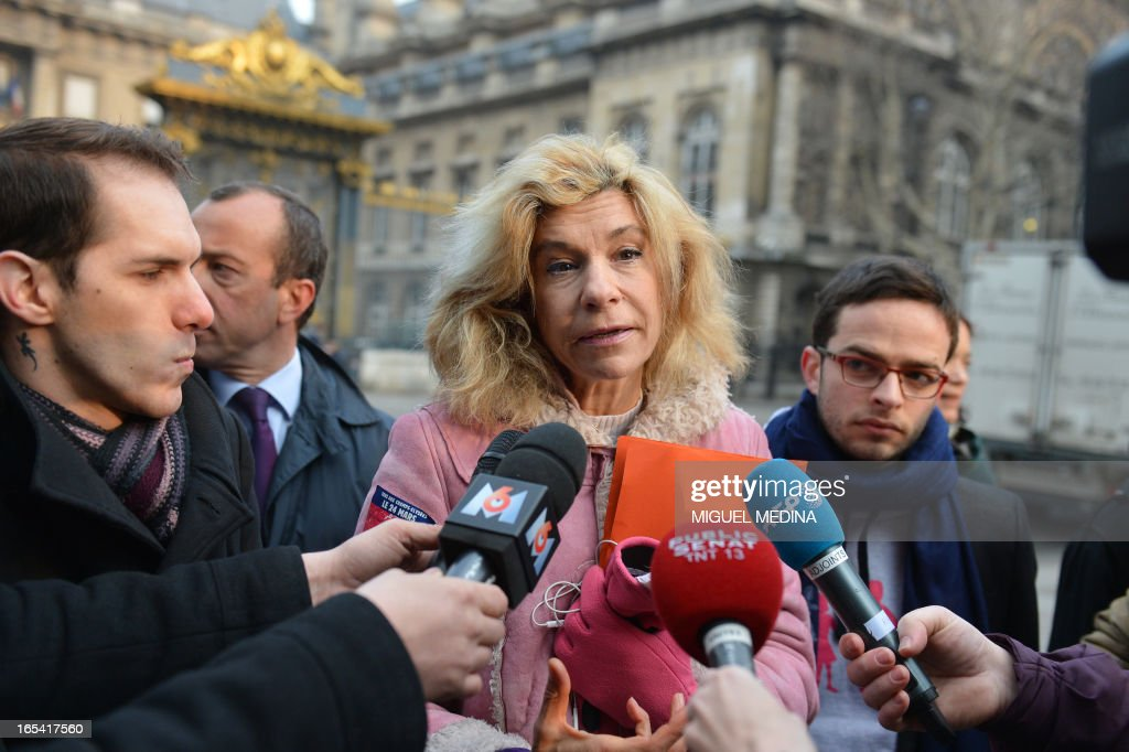 Anti gay marriage activist Virginie Tellene, aka Frigide Barjot, representing the anti gay marriage association 'Manif pour tous !' (Demonstration for all !), speaks to journalists in front of the Paris courthouse on April 4, 2013, before make a claim of defamation against French Socialist Party's (PS) Senator Jean-Pierre Michel, who has described them as 'the worst homophobic people'.