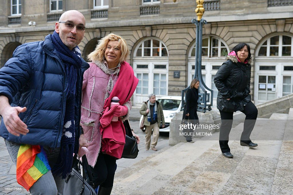Anti gay marriage activist Virginie Tellene, aka Frigide Barjot (2ndL), representing the anti gay marriage association 'Manif pour tous !' (Demonstration for all !) arrives with a supporter at the Paris courthouse on April 4, 2013 to make a claim of defamation against French Socialist Party's (PS) Senator Jean-Pierre Michel, who has described them as 'the worst homophobic people'.