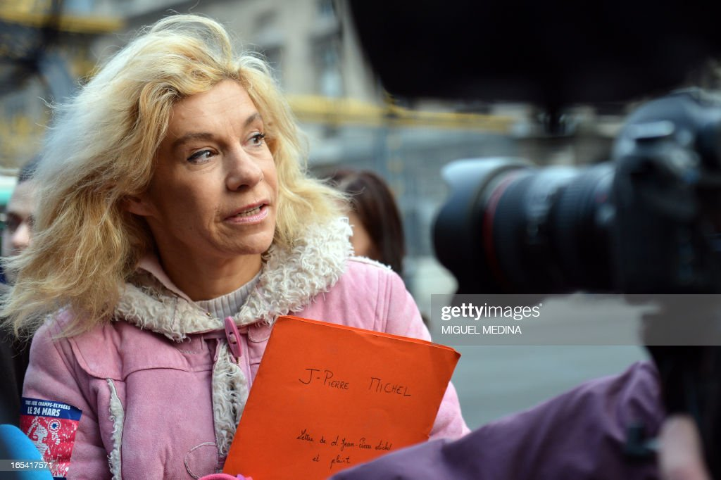 Anti gay marriage activist Virginie Tellene, aka Frigide Barjot, representing the anti gay marriage association 'Manif pour tous !' (Demonstration for all !), speaks to journalists as she arrives at the Paris courthouse on April 4, 2013 to make a claim of defamation against French Socialist Party's (PS) Senator Jean-Pierre Michel, who has described them as 'the worst homophobic people'.