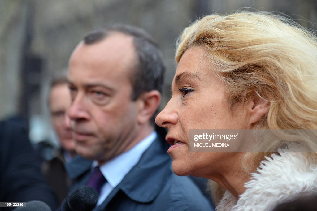 Anti gay marriage activist Virginie Tellene (R), aka Frigide Barjot, representing the anti gay marriage association 'Manif pour tous !' (Demonstration for all !), speaks to journalists as she arrives with her lawyer Alexandre Varaut (L) at the Paris courthouse on April 4, 2013 to make a claim of defamation against French Socialist Party's (PS) Senator Jean-Pierre Michel, who has described them as 'the worst homophobic people'. AFP PHOTO / MIGUEL MEDINA