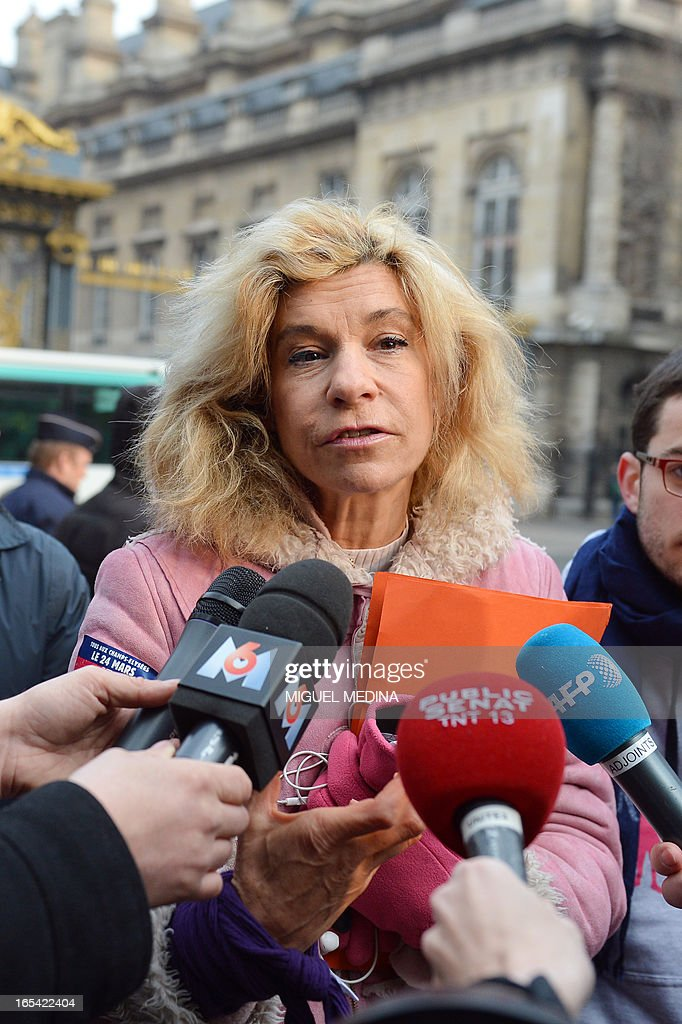 Anti gay marriage activist Virginie Tellene, aka Frigide Barjot, representing the anti gay marriage association 'Manif pour tous !' (Demonstration for all !), speaks to journalists as she arrives at the Paris courthouse on April 4, 2013 to make a claim of defamation against French Socialist Party's (PS) Senator Jean-Pierre Michel, who has described them as 'the worst homophobic people'. AFP PHOTO / MIGUEL MEDINA