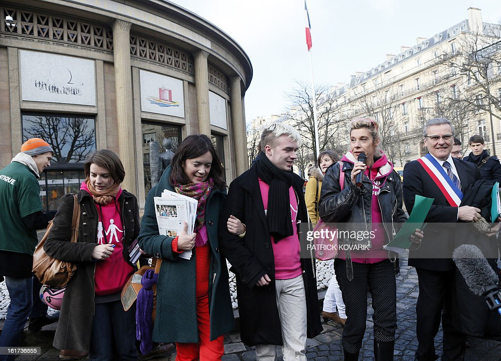 Anti gay marriage activists (From 2nd L) Laurence Tcheng, from the association 'La gauche pour le mariage républicain', Xavier Bongibault, from the association 'Plus gay sans mariage,' humorist Frigide Barjot, and Le Chesnay's mayor Philippe Brillault, address reporters as they leave French Economic and Social Council where they handed over a petition against the National Assembly endorsed controversial bill to legalise same-sex marriage and adoption, on February 15, 2013 in Paris. The bill, comfortably adopted five days ago by the primary chamber, still has to go to the Senate for examination and approval, but the upper house is unlikely to prevent the groundbreaking reform from becoming law by the summer.