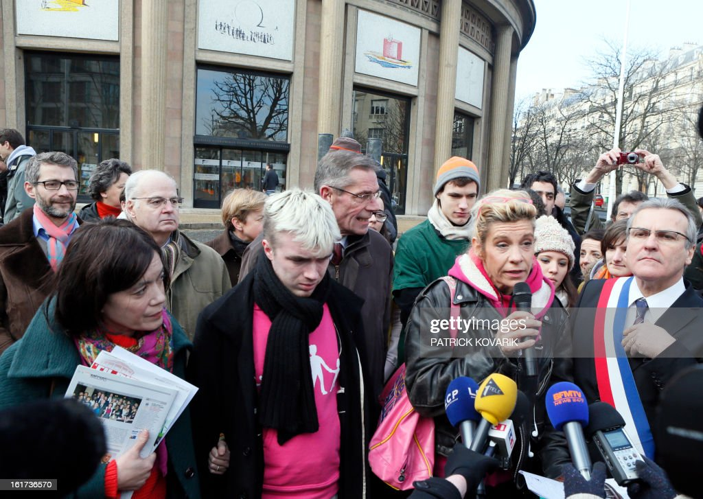 Anti gay marriage activists (From L) Laurence Tcheng, from the association 'La gauche pour le mariage républicain', Xavier Bongibault, from the association 'Plus gay sans mariage,' humorist Frigide Barjot, and Le Chesnay's mayor Philippe Brillault, address reporters as they leave French Economic and Social Council where they handed over a petition against the National Assembly endorsed controversial bill to legalise same-sex marriage and adoption, on February 15, 2013 in Paris. The bill, comfortably adopted five days ago by the primary chamber, still has to go to the Senate for examination and approval, but the upper house is unlikely to prevent the groundbreaking reform from becoming law by the summer.